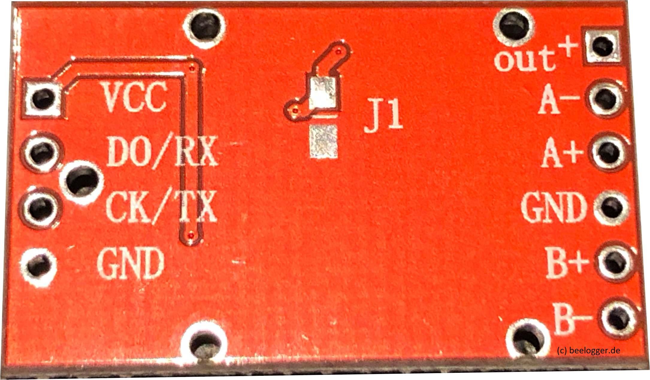HX711Platine, rot mit vollständiger Bestückung beider Kanäle, hier Bild der Rückseite
