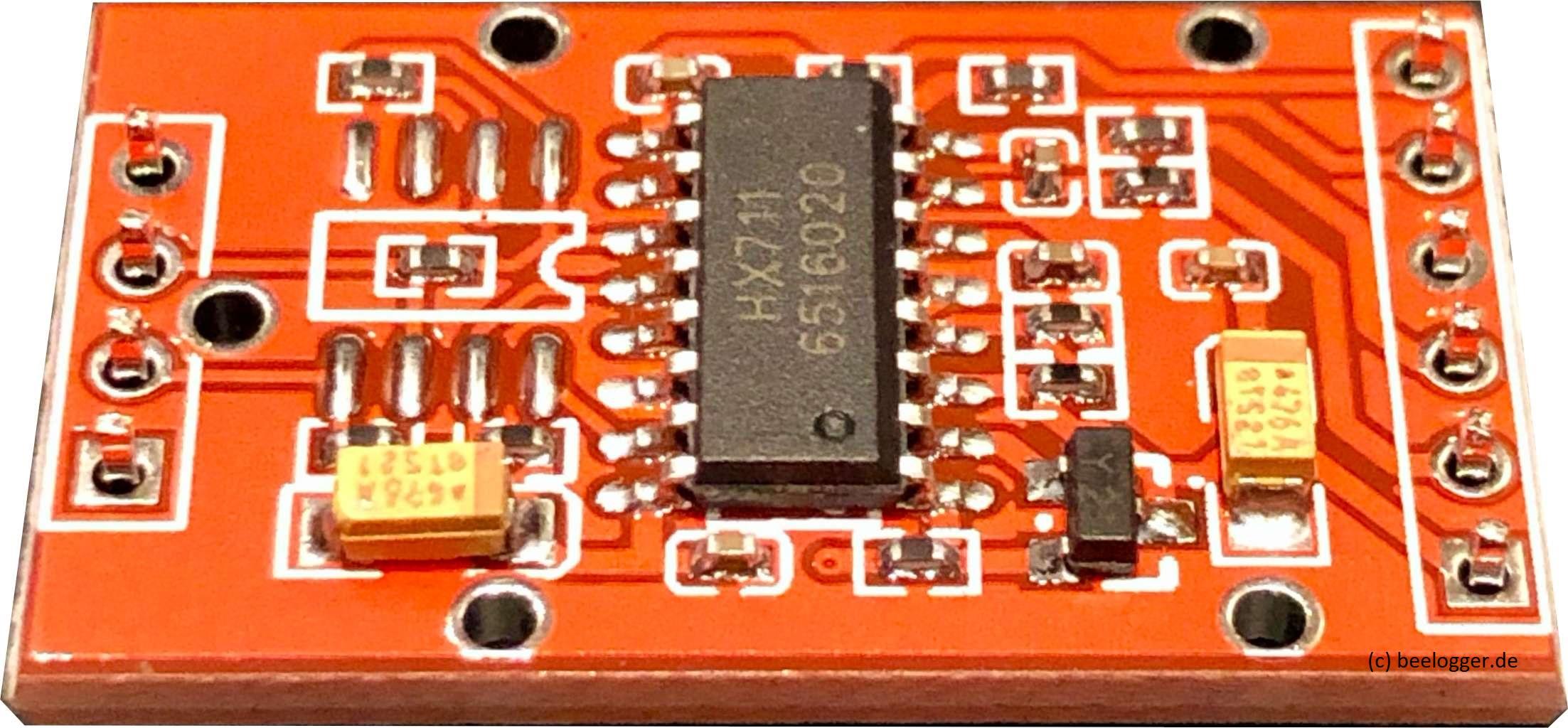 HX711Platine, rot mit vollständiger Bestückung beider Kanäle, hier Bild der Bestückungsseite